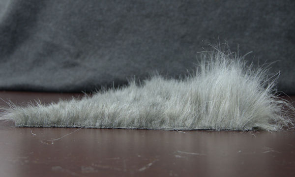 Side view of shaved piece of faux fur.