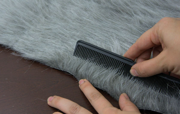 Combing faux fur away from the seam.