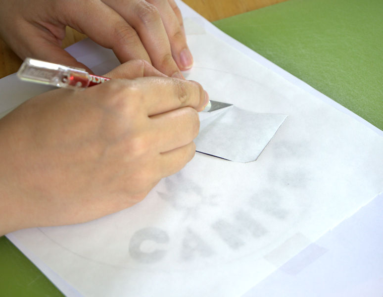 Cutting the freezer paper stencil with an X-Acto knife