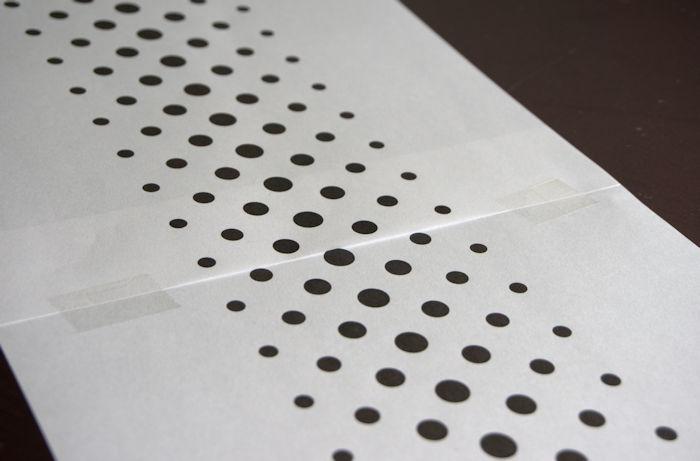 Two sheets of printed geometric dots taped together