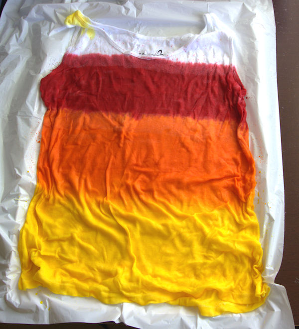 Tank top with red, orange and yellow stripes of dye