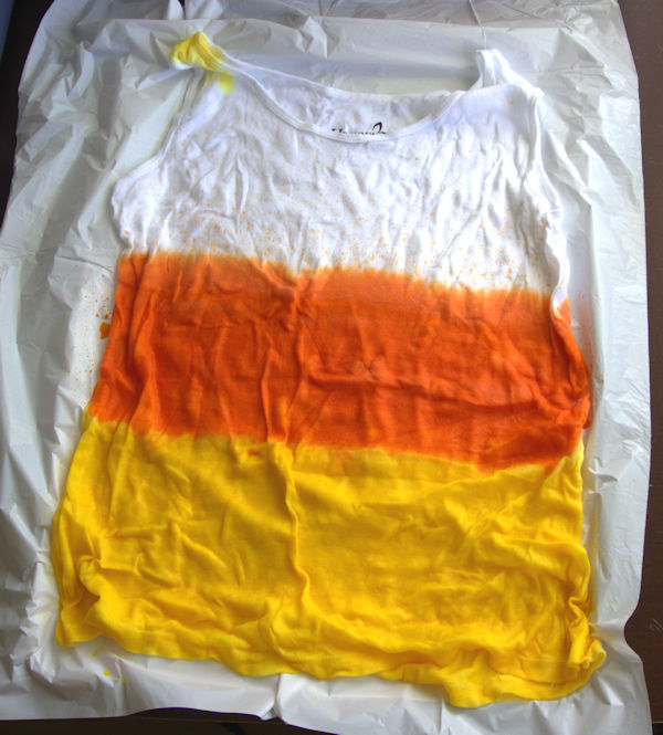 White tank top with yellow and orange dye stripes