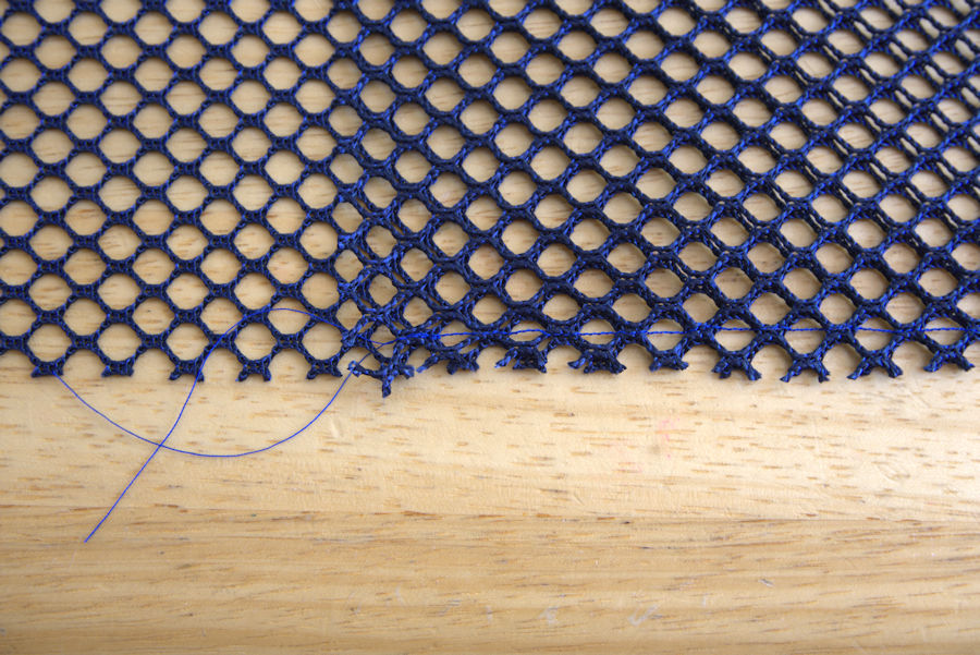 Mesh sewn 1/2 inch away from edge