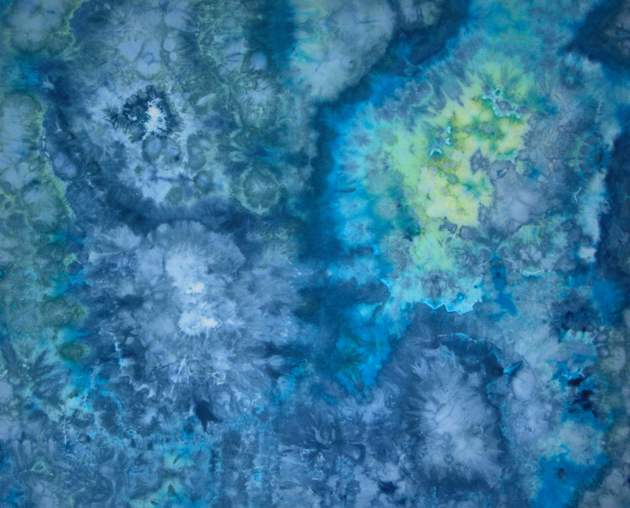 Blue, green and turquoise ice dyed fabric
