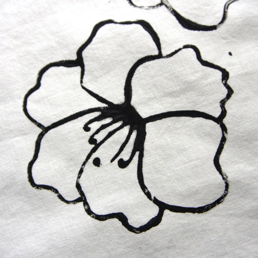 Finished stamp stamped onto fabric with black ink