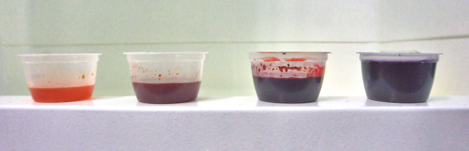 Cups filled with several colors of dye