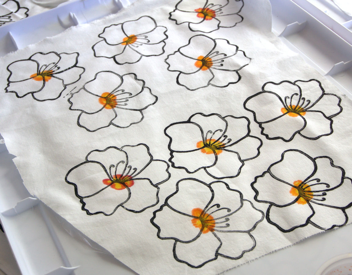 Printed flowers with painted orange center