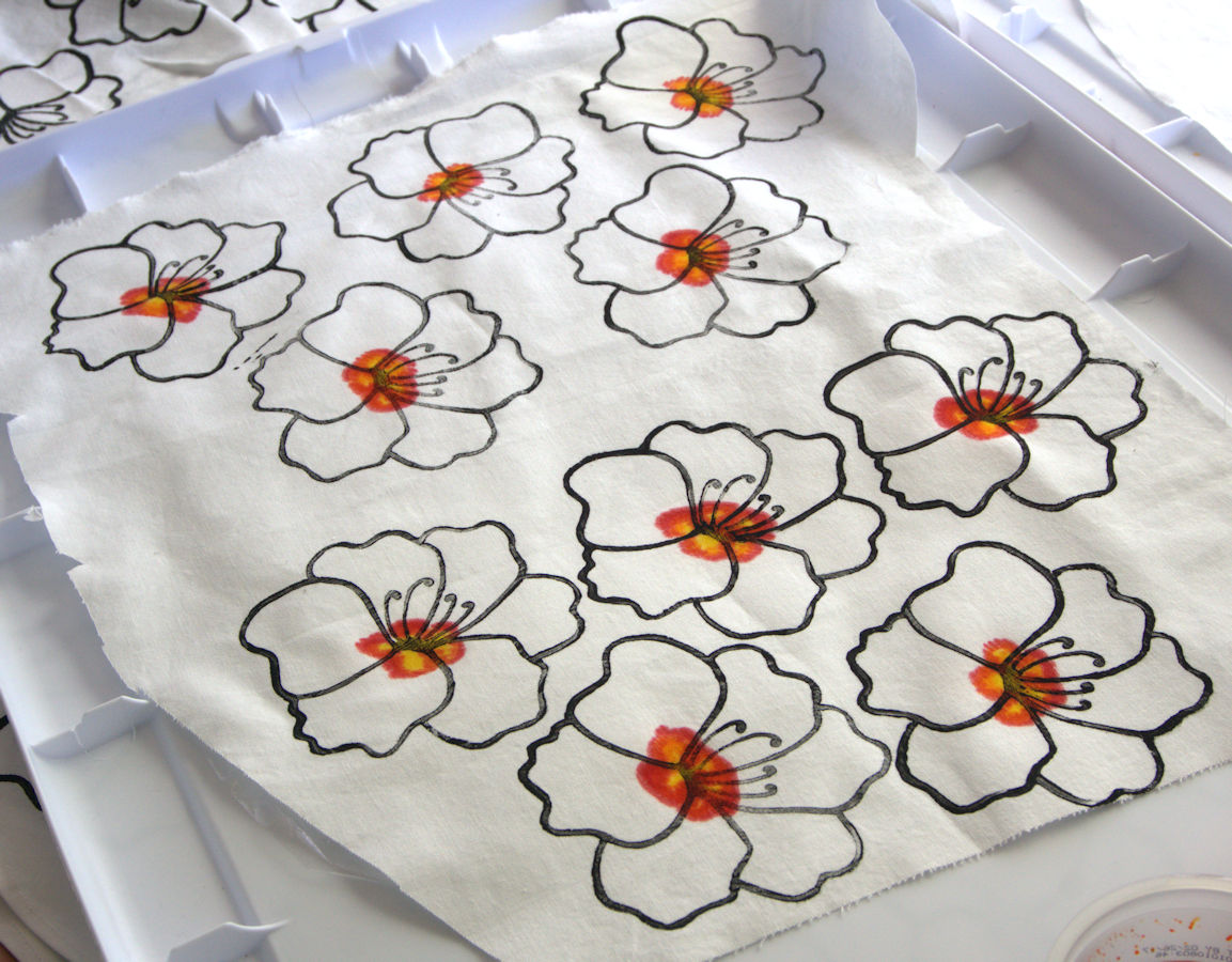 Printed flowers with painted red and yellow center