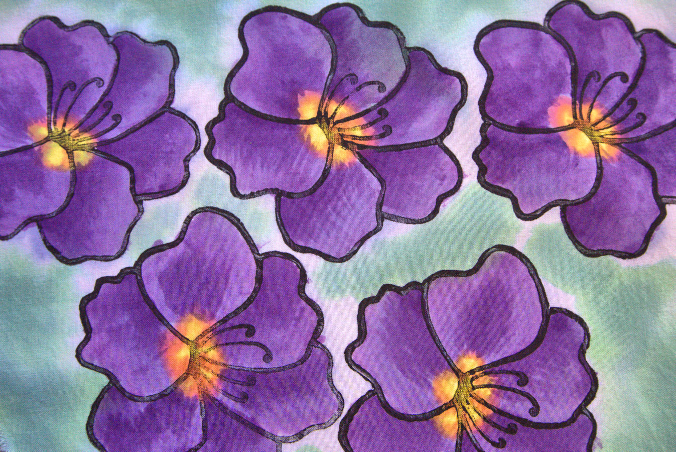 Purple painted flowers on fabric