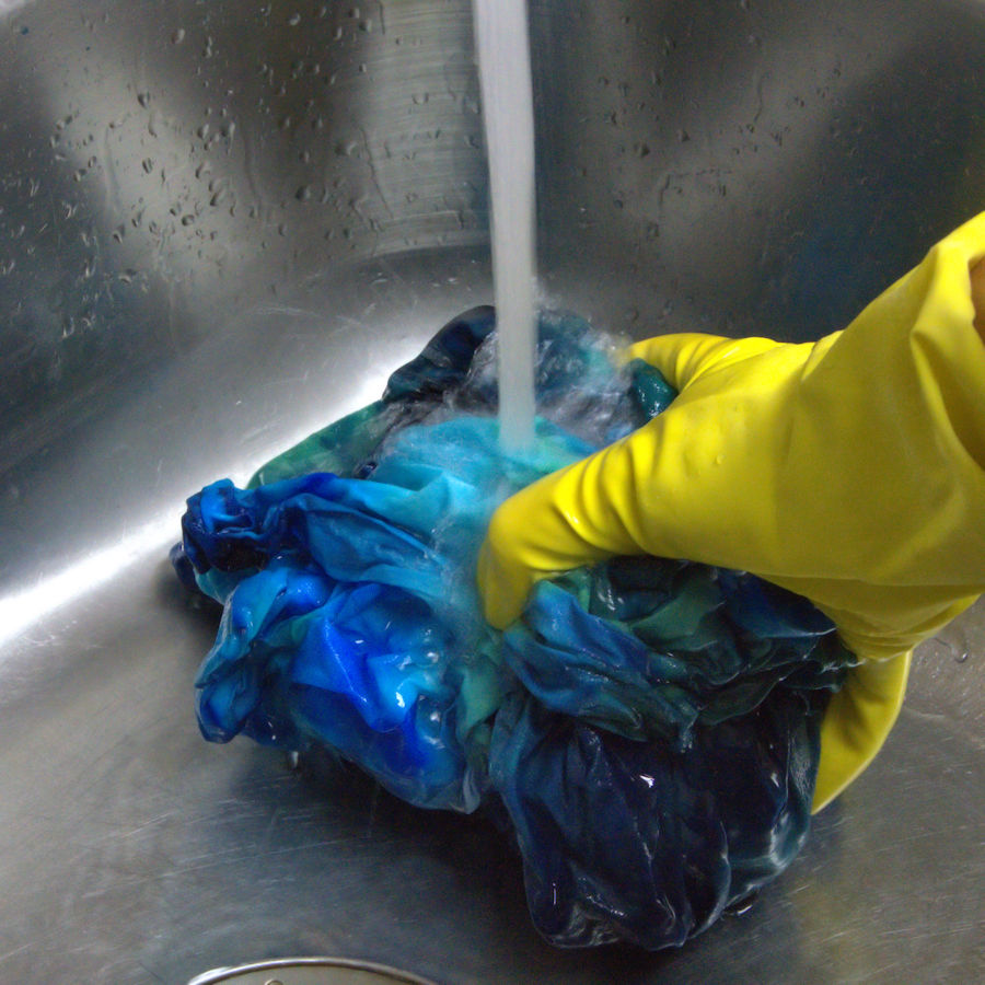 Blue dyed fabric under running water
