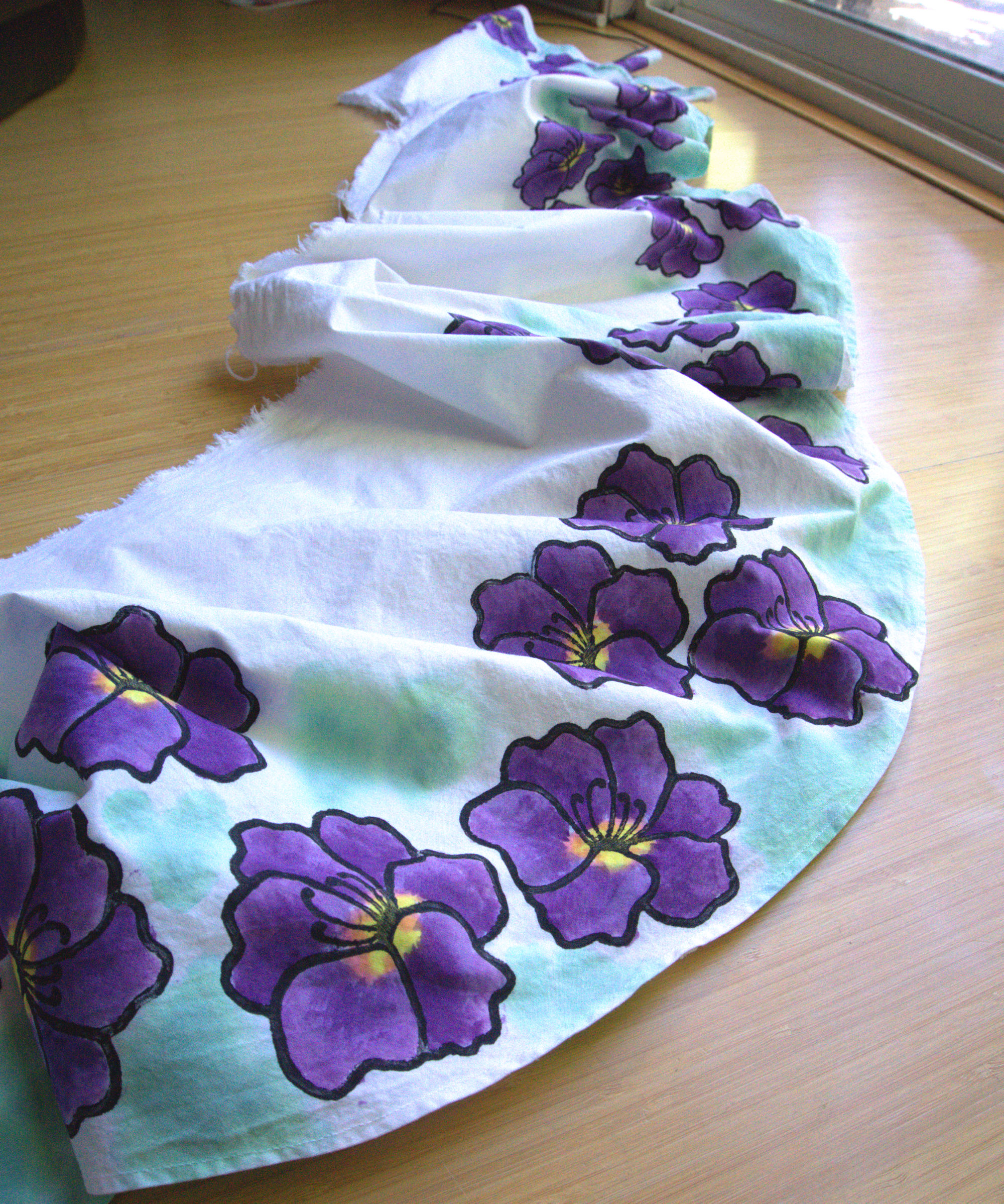 Purple flowers on green and white watercolor fabric