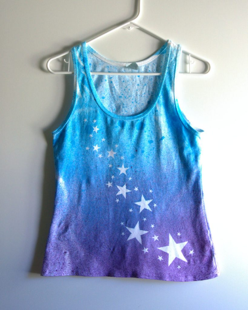 Purple and turquoise spray dyed tee with trail of white stars