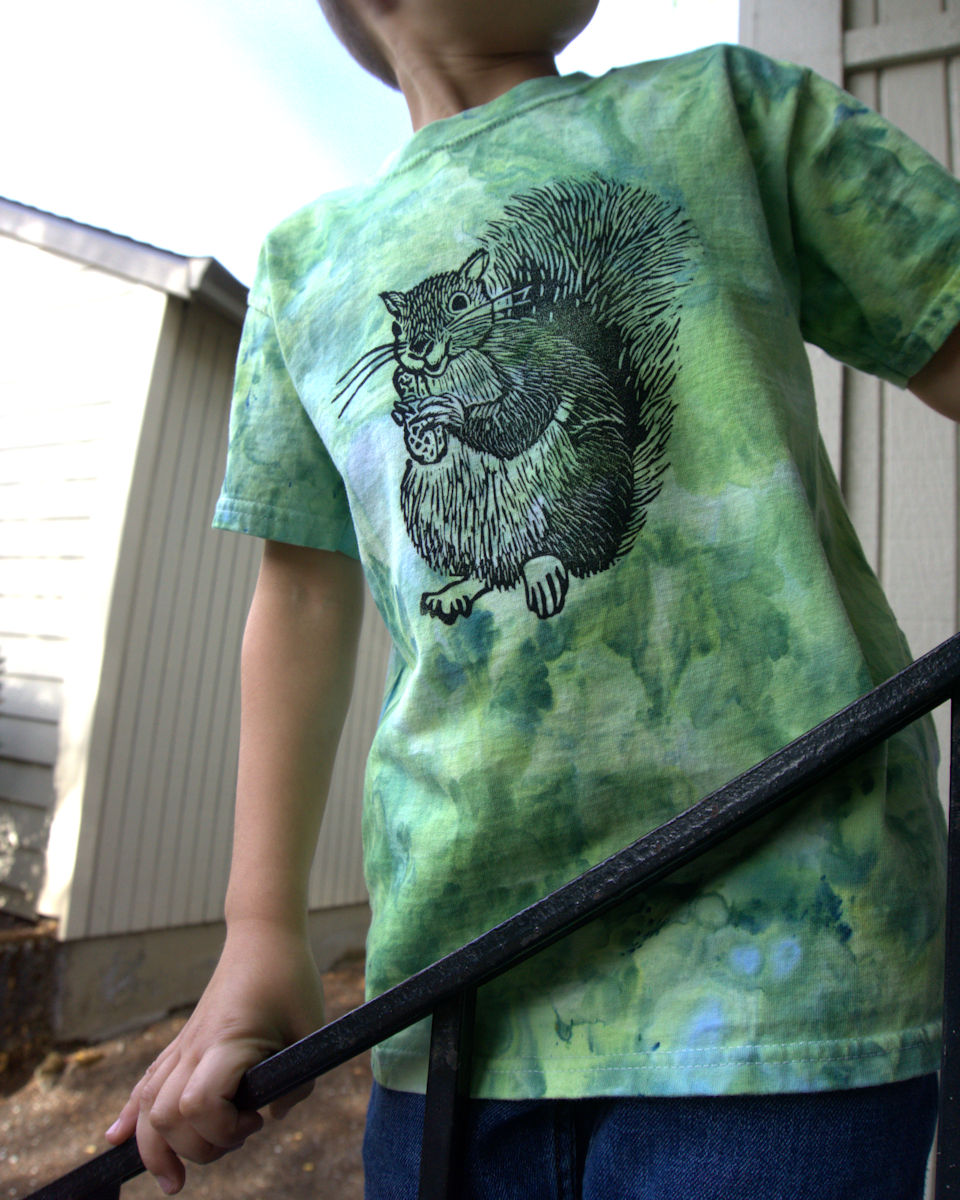 Standing on stairs wearing T-shirt with squirrel image
