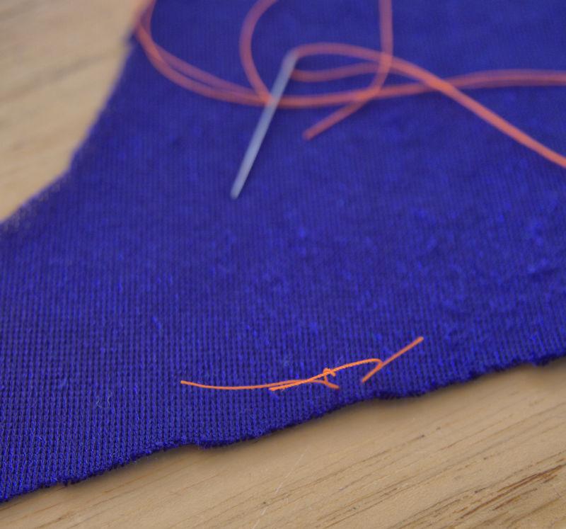 Tailor's tack on blue velvet