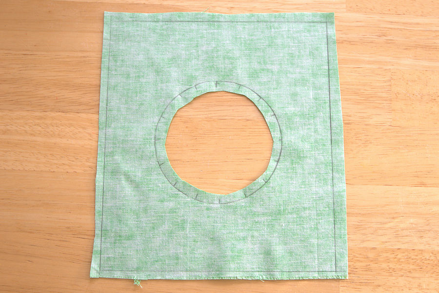 Green fabric with hole in center