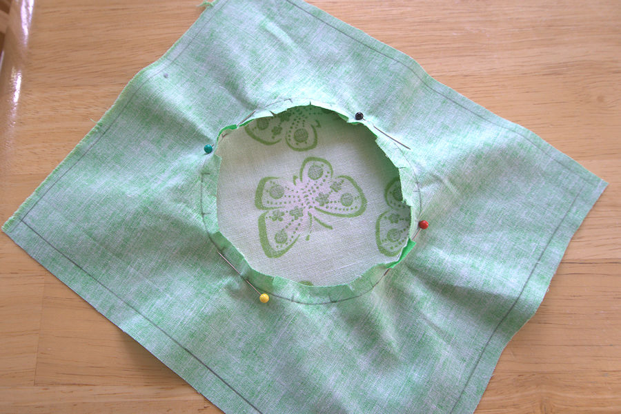 Fabric circle pinned with four pins at opposite sides