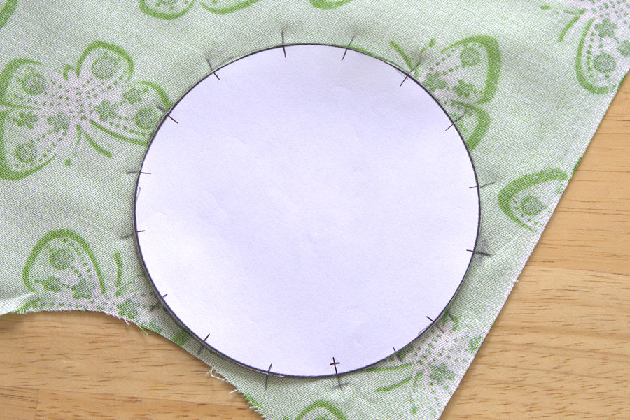 Circle stencil on green butterfly fabric