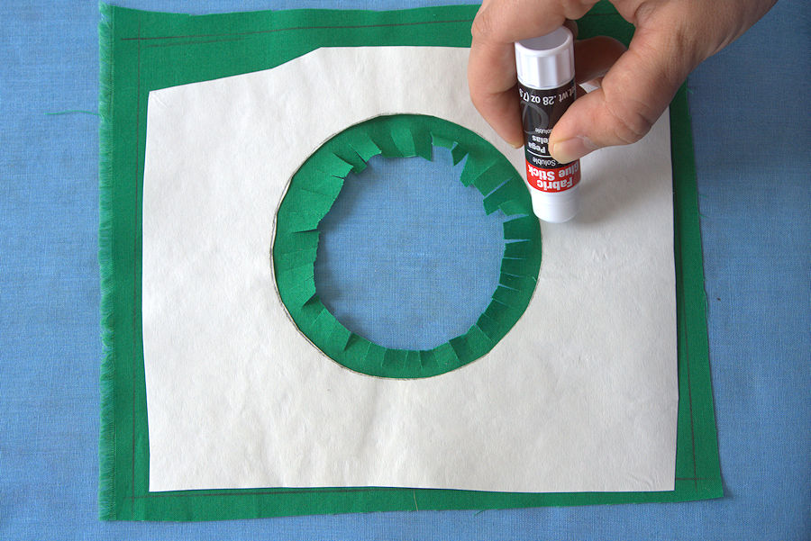 Adding glue to freezer paper
