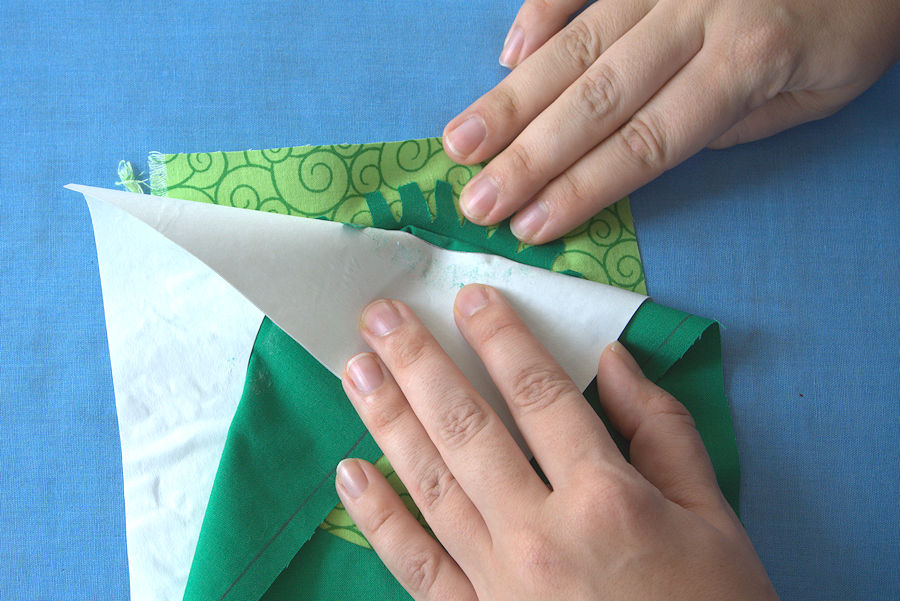 Peeling the freezer paper away from the fabric
