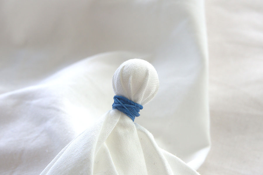 Marble tied in fabric with rubber band