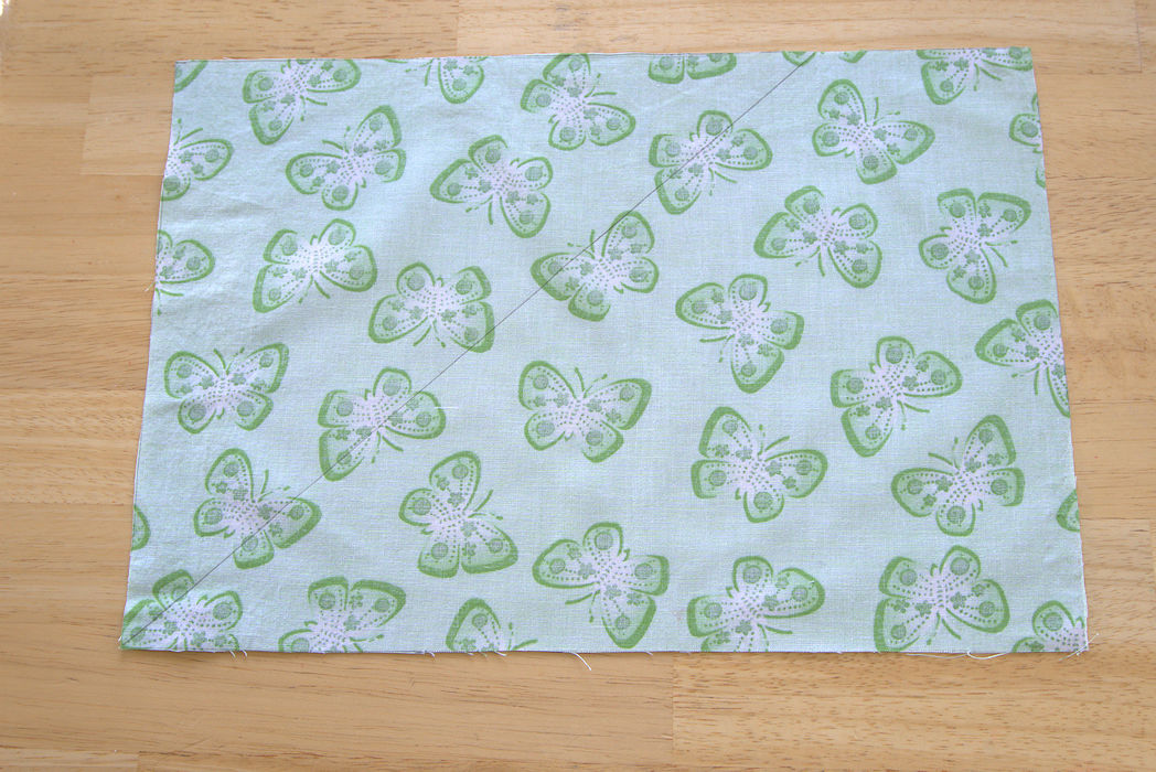 Diagonal line drawn on green butterfly fabric
