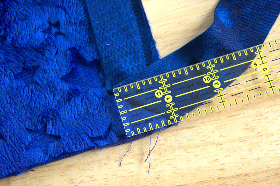 Checking binding's 45 degree angle using a quilting ruler