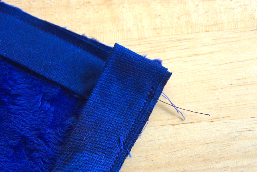 Stitching on second side of binding