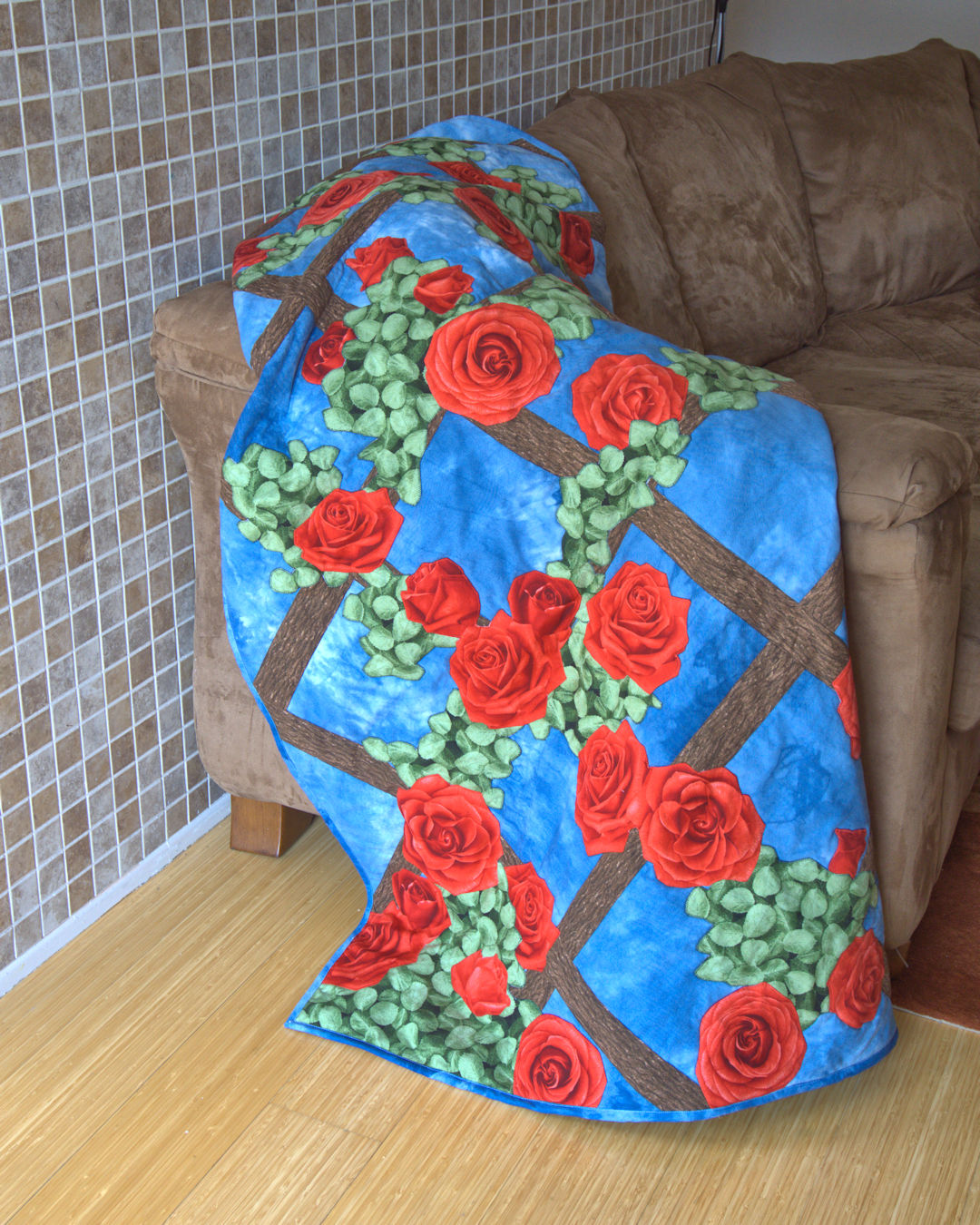 Rose trellis applique quilt over couch