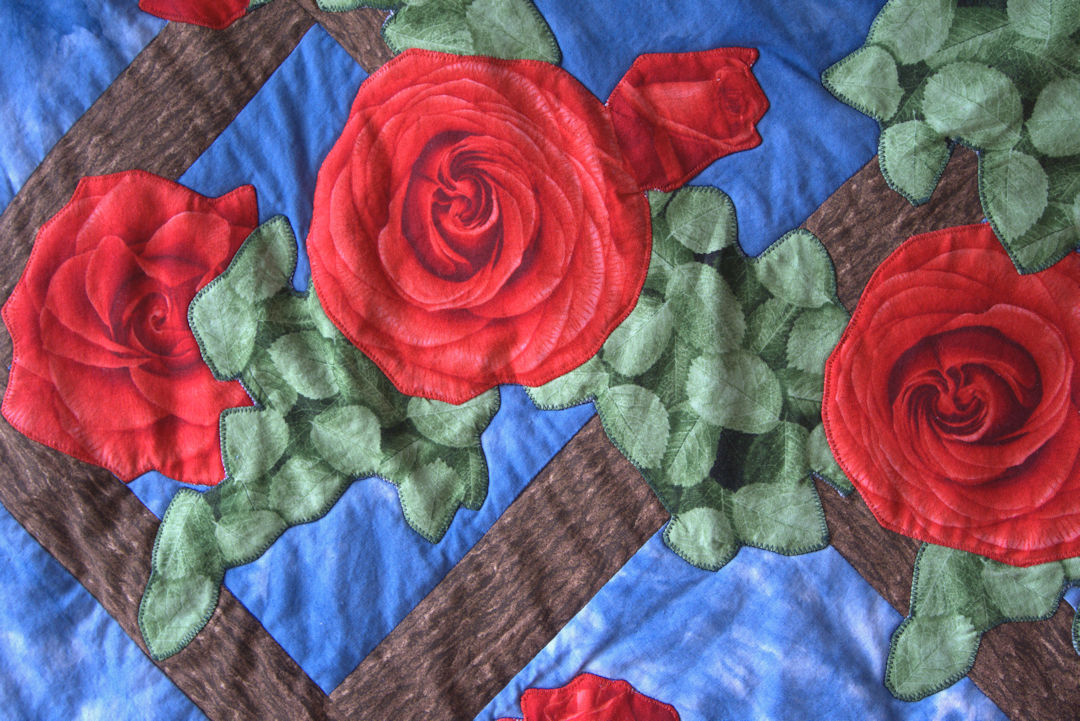 Closeup of applique roses on lattice quilt