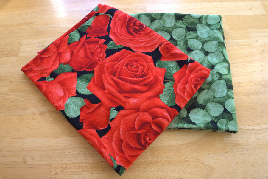 Red rose and green leaf fabric