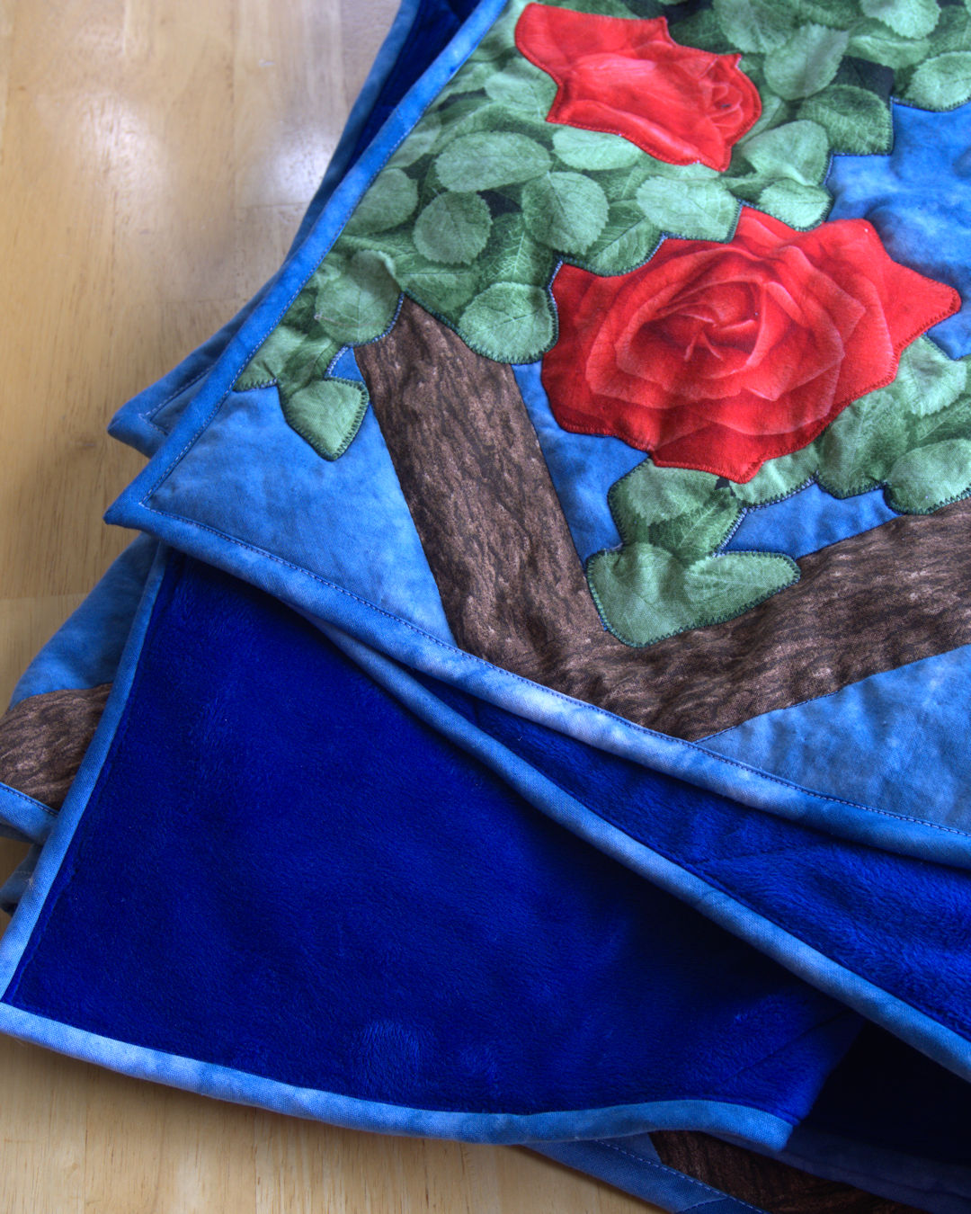 Blue minky backing on flower applique quilt