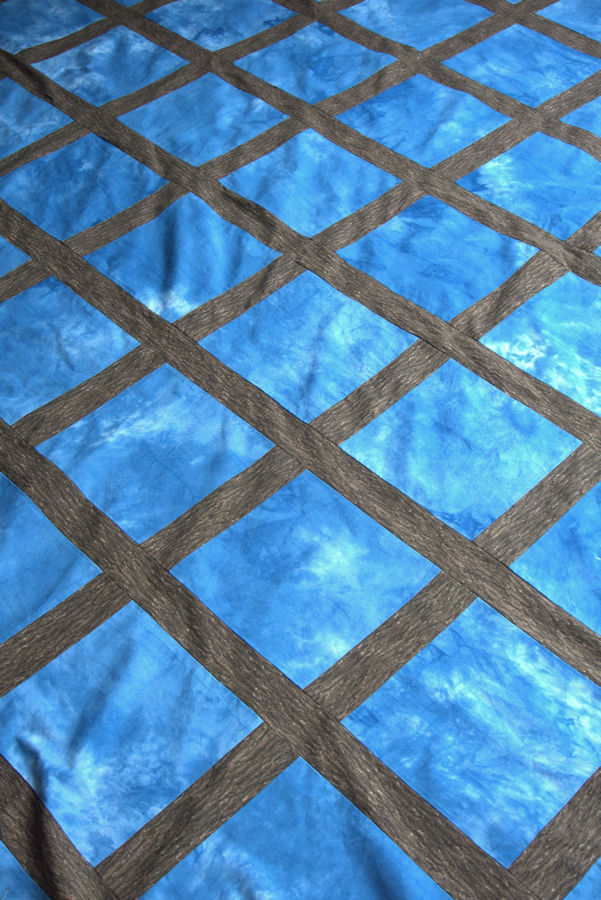 Blue and brown lattice quilt top