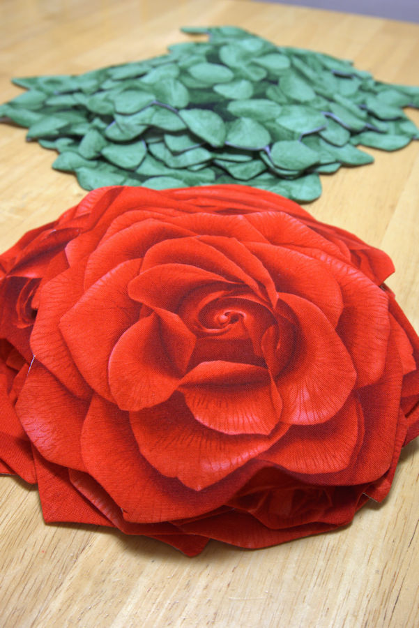 Piles of rose and leaf appliques
