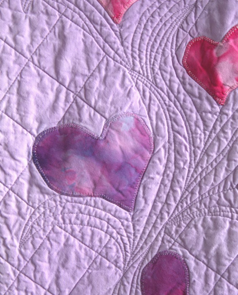 Detail of ice dyed heart applique