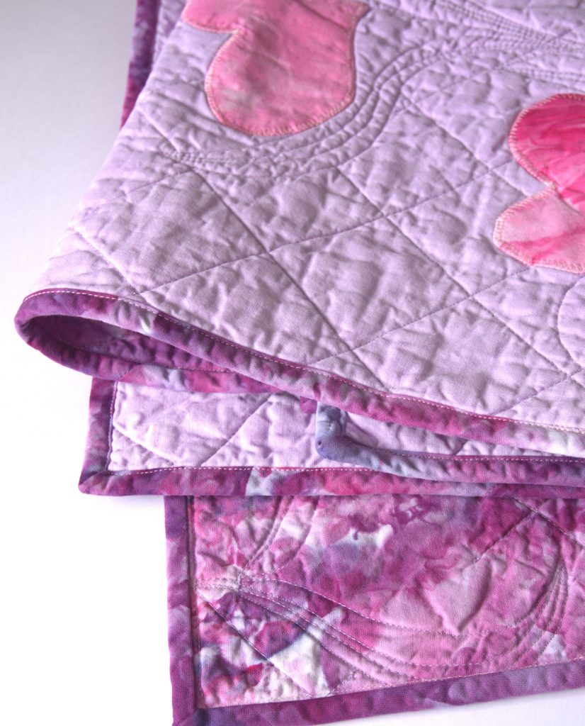 Folded heart applique quilt