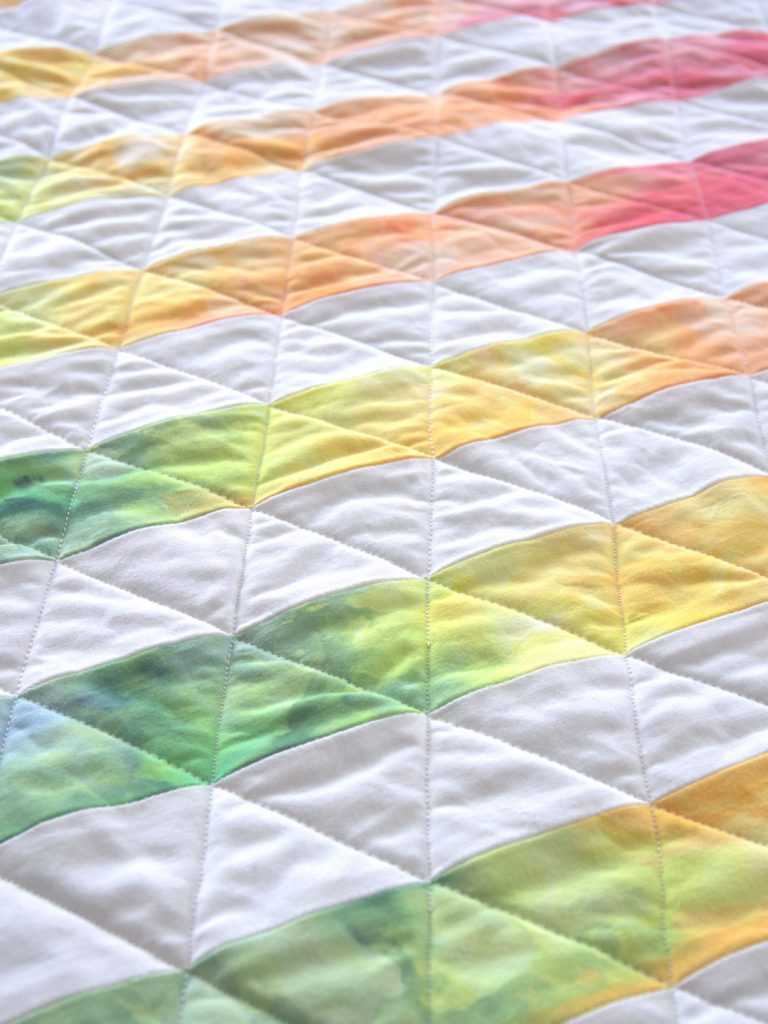 Rainbow stripe quilted triangles