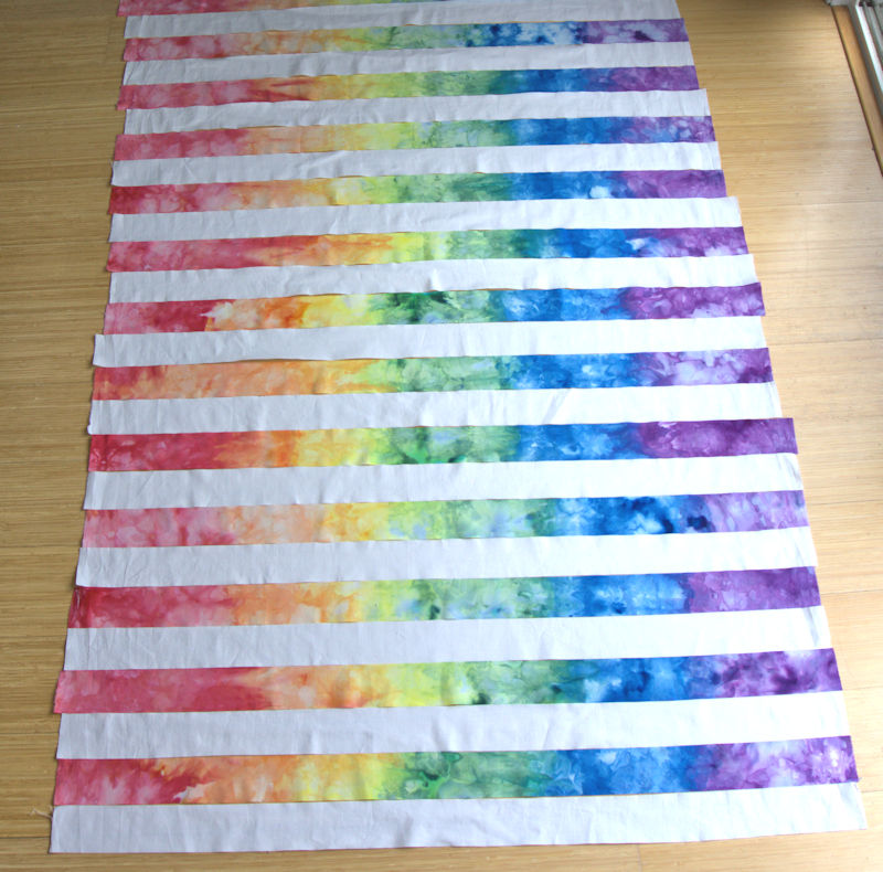 Ice dyed rainbow strips quilt top in same direction