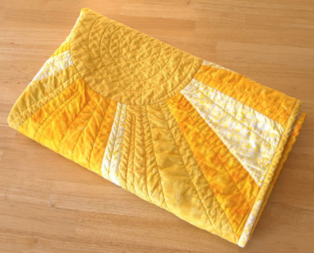 Folded sunshine quilt