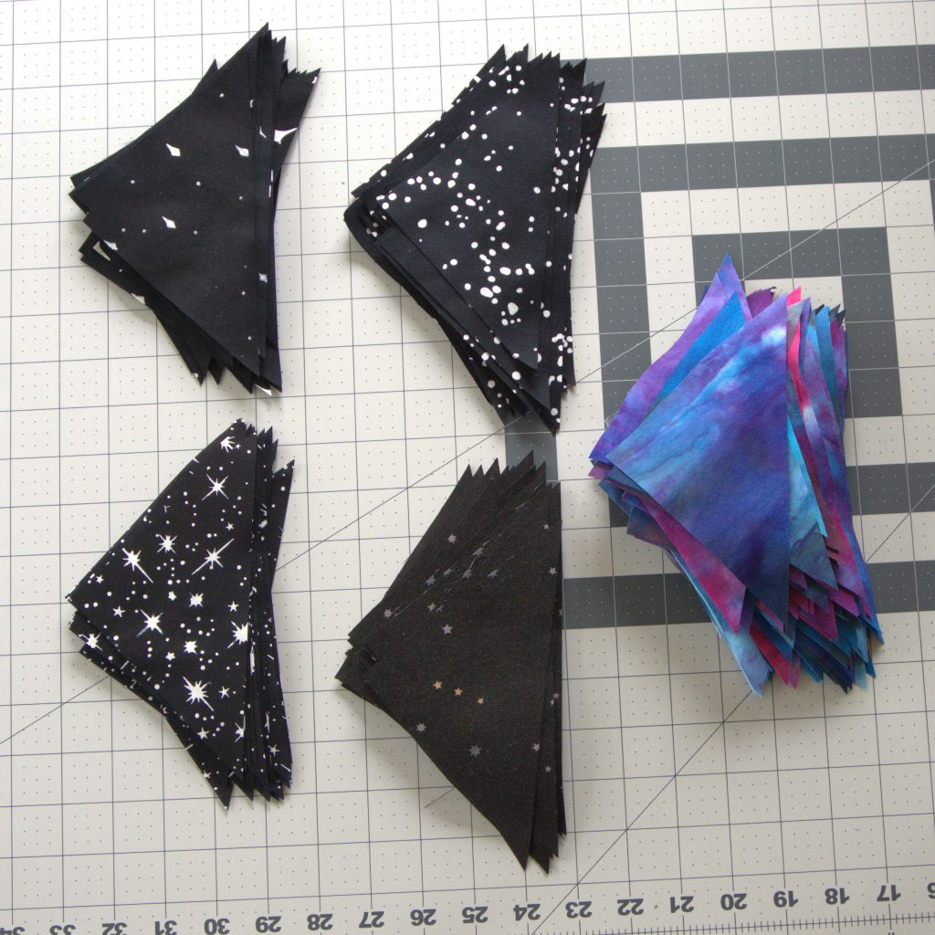Half square triangles in black and galaxy colors