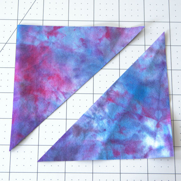 Two triangles cut from block of fabric
