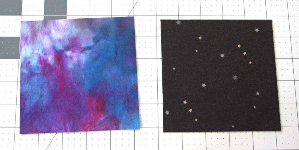 Squares of hand dyed fabric and black star fabric