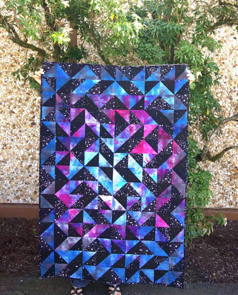 Half square triangle galaxy quilt
