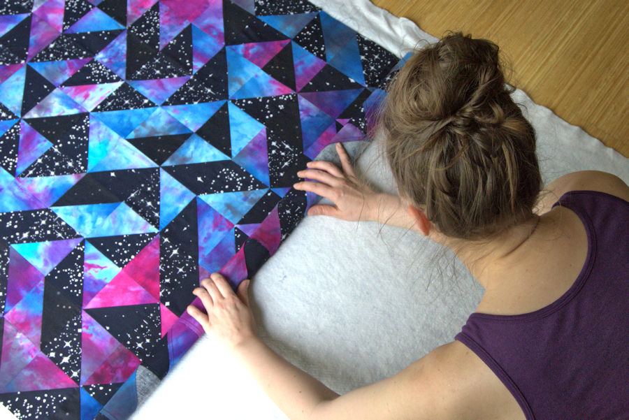 Rolling up galaxy quilt top