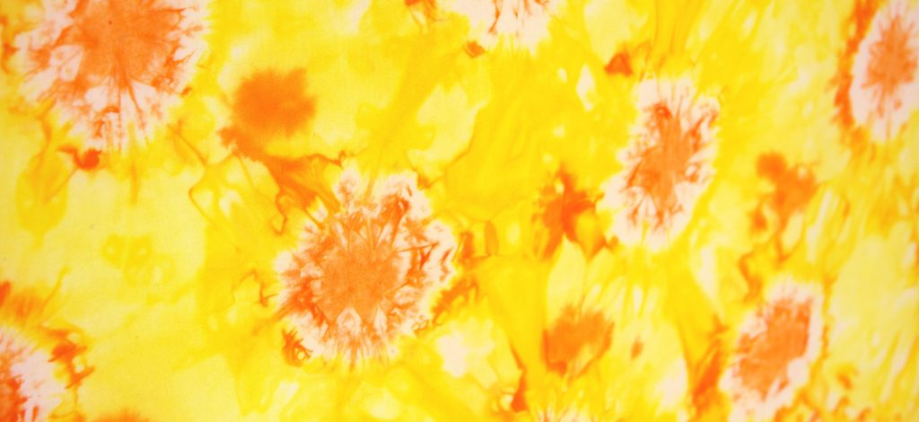 Shibori tie dye suns in yellow and orange
