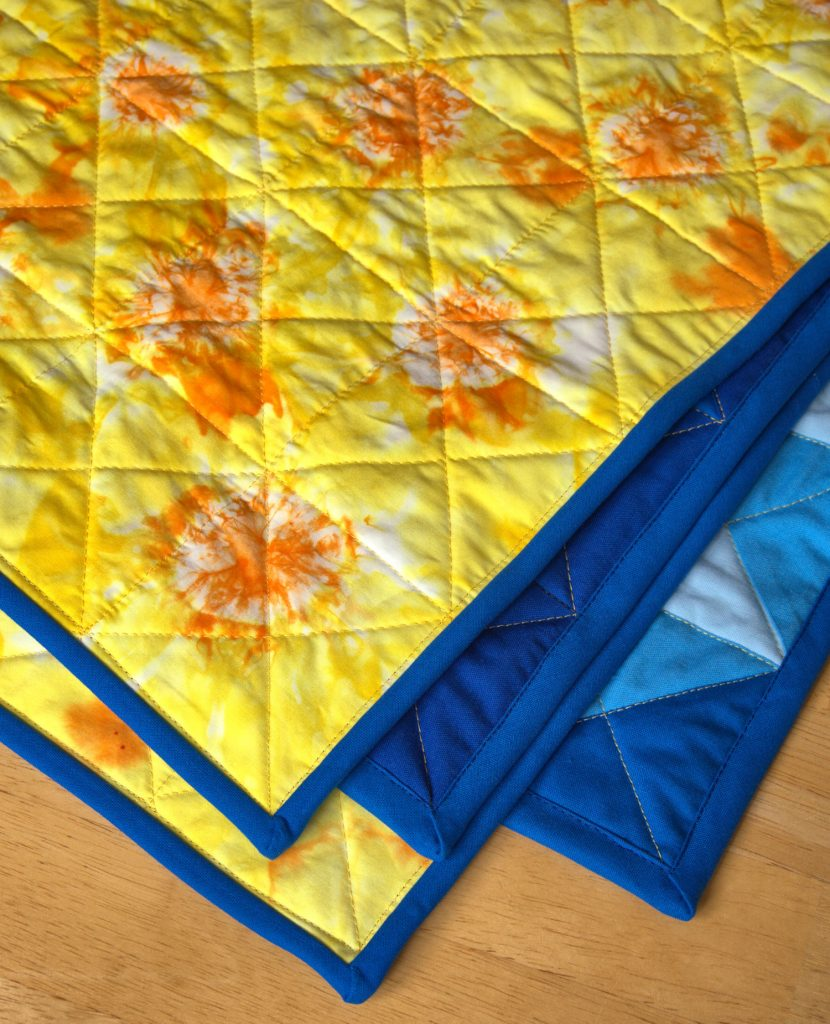 Shibori tie dye suns on back of quilt