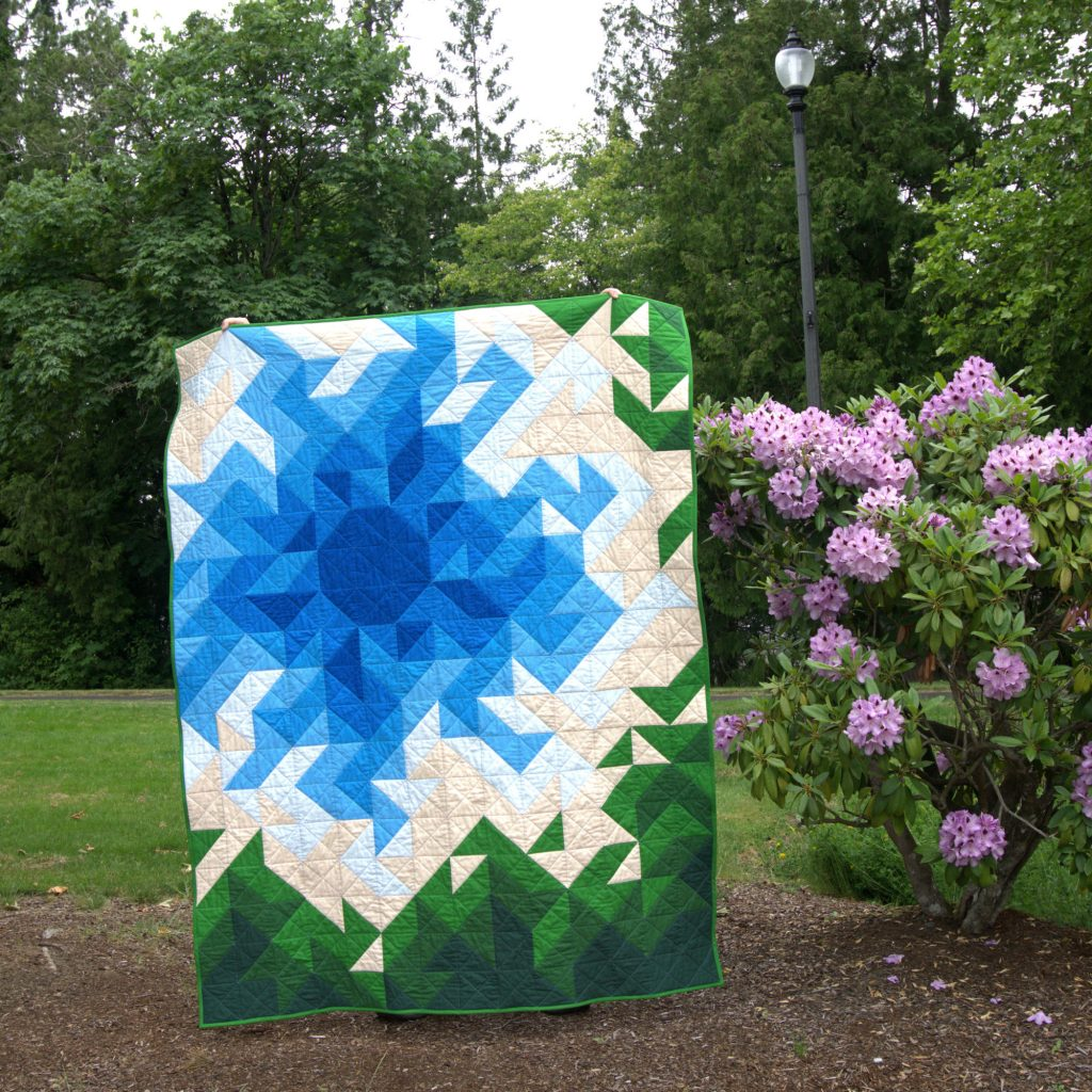 Summer Brilliance quilt in blue and green