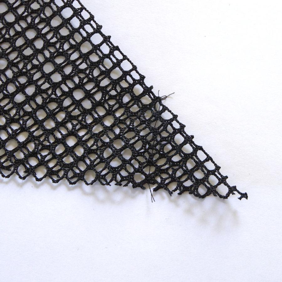 Sewn corner of mesh