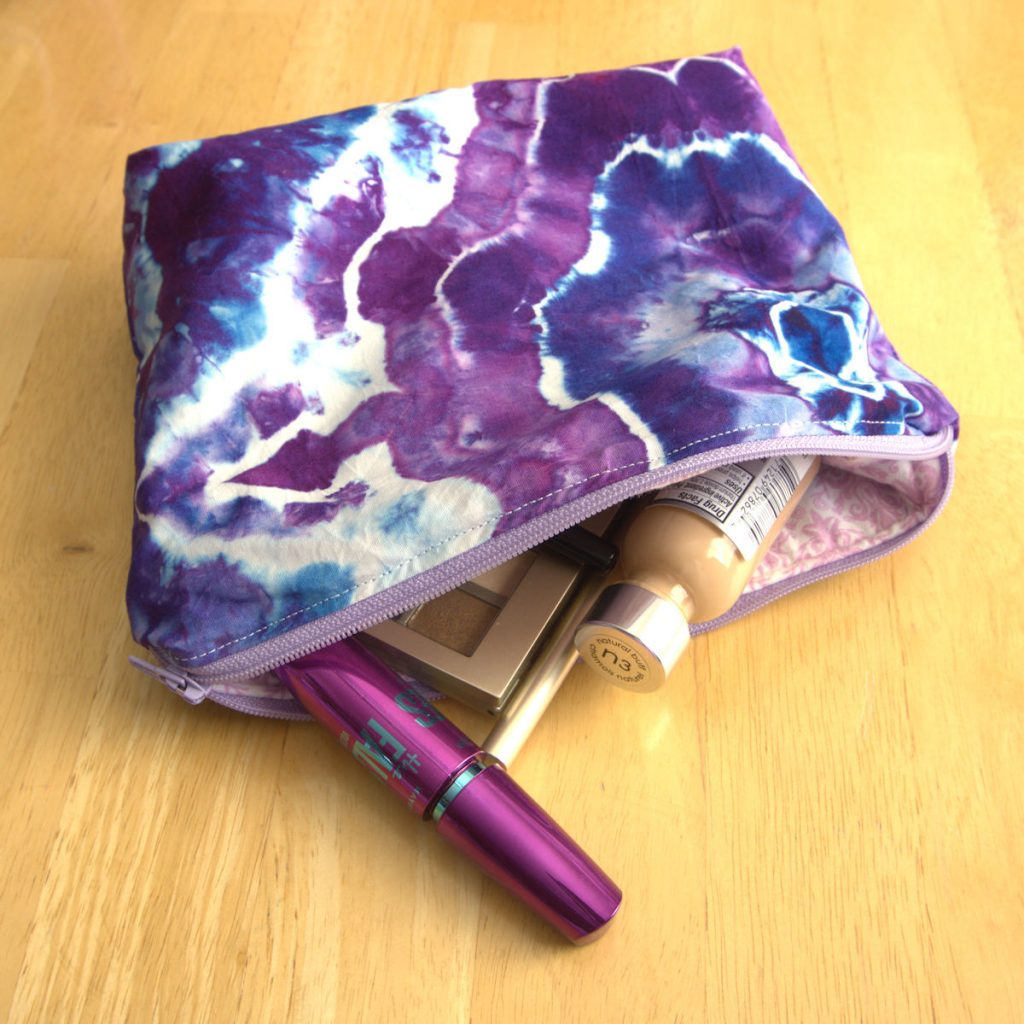Puple geode bag with cosmetics