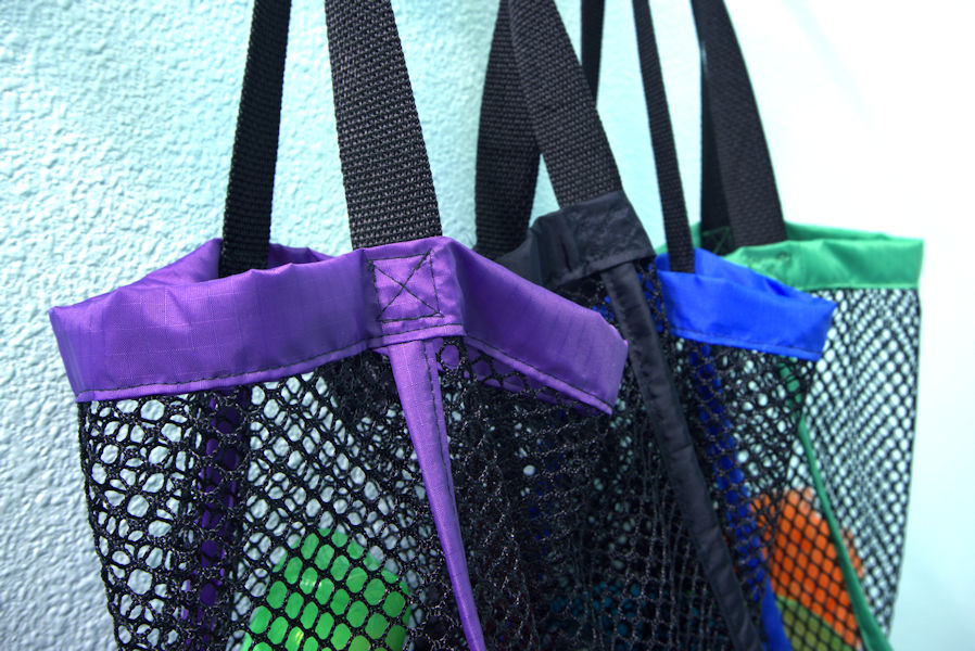Color coordinated mesh camp shower bags