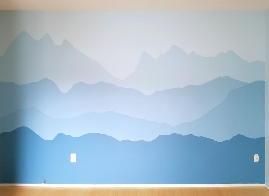 Blue mountain accent wall in nursery